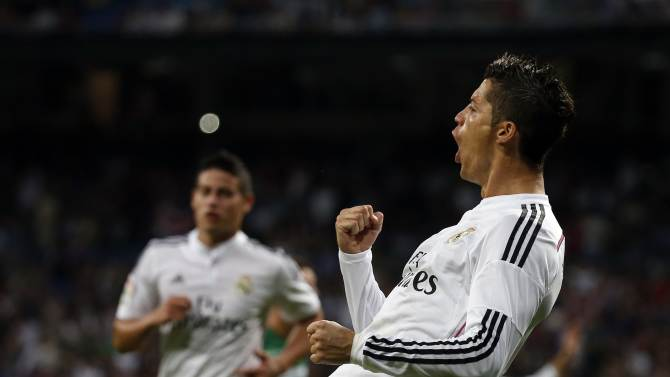 Real Madrid's Ronaldo celebrates after scoring a goal against Elche during their Spanish first division soccer match in Madrid
