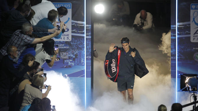 Roger Federer of Switzerland arrives on court to play Janko Tipsarevic of Serbia during their ATP World Tour Finals singles tennis match at the O2 Arena in London, Tuesday, Nov. 6, 2012. (AP Photo/Sang Tan)