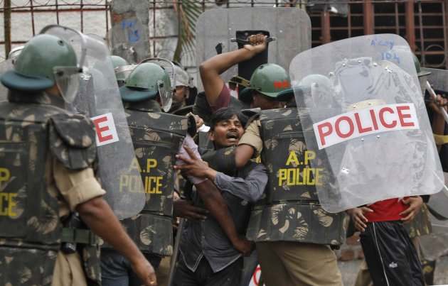 Police detain a Pro-Telangana supporter during a protest in Hyderabad