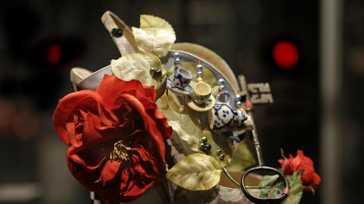 "This Feb. 11, 2013 photo shows a shoe decorated with a miniature tea set and a lock titled ""Alice,"" and designed by Nicholas Kirkwood, on display at the ""Shoe Obsession"" exhibit at The Museum at the Fashion Institute of Technology Museum in New York. The exhibition, showing off 153 specimens, runs through April 13. (AP Photo/Kathy Willens)"
