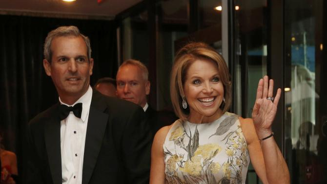 Journalist Couric and her husband Molner arrive for the annual White House Correspondents' Association dinner in Washington