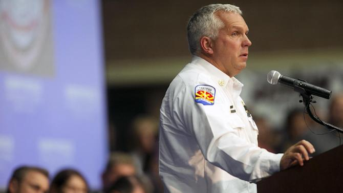 Prescott Fire Marshal Don Devendorf speaks during a memorial service for 19 firefighters of the Granite Mountain Hotshot Crew that were killed battling a wildfire, Monday, July 1, 2013 in Prescott, Ariz. (AP Photo/The Arizona Republic, David Wallace)