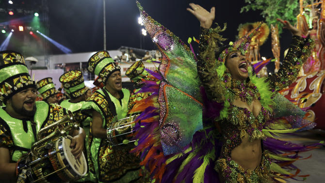 Revellers parade for the Mocidade Alegre samba school during the carnival in Sao Paulo, Brazil