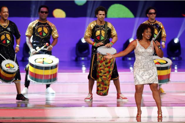 Brazilian singer Margareth Menezes performs with percussion group Olodum during the draw for the 2014 World Cup at the Costa do Sauipe resort in Sao Joao da Mata