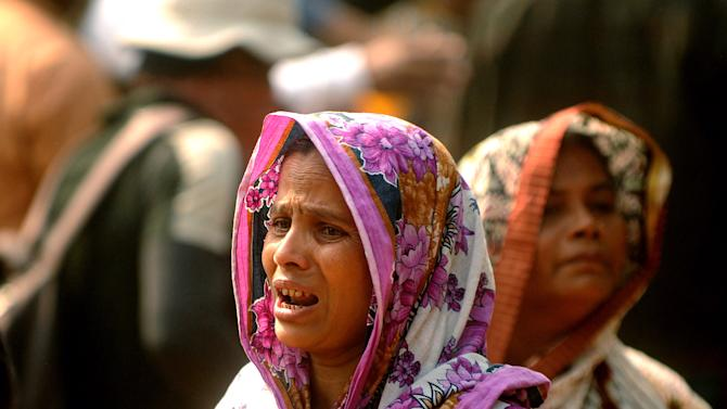 A Bangladeshi woman whose relative was killed in a fire at a garment factory cries outside a mortuary outside Dhaka, Bangladesh, Sunday, Nov. 25, 2012. At least 112 people were killed late Saturday night in a fire that raced through the multi-story garment factory just outside of Bangladesh's capital, an official said Sunday. (AP Photo/Hasan Raza)
