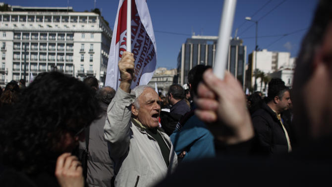 An elderly member of pro-communist union PAME shouts slogans during a protest in Athens, Wednesday, Feb. 20, 2013. Thousands of anti-austerity demonstrators took to the streets of Athens on Wednesday as unions staged a general strike to protest the government's spending cuts and tax hikes, which some predict will push unemployment to a stunning 30 percent this year. (AP Photo/Kostas Tsironis)