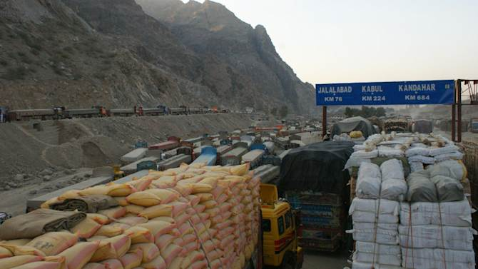 Trucks are parked at a road as authorities closed the Torkham border for NATO supply trucks at Pakistani border town of Torkham on Saturday, Nov 26, 2011. Pakistan on Saturday accused NATO helicopters of firing on two army checkpoints in the northwest and killing 25 soldiers, then retaliated by closing a key border crossing used by the coalition to supply its troops in neighboring Afghanistan. (AP Photo/Qazi Rauf)
