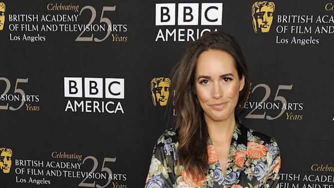 "FILE - This Sept. 22, 2012 file photo shows Louise Roe, Glamour magazine's editor at large and the new host of NBC's ""Fashion Star,"" posing at the British Academy of Film and Television Arts Los Angeles TV Tea 2012 party at The London Hotel in West Hollywood, Calif. (Photo by Chris Pizzello/Invision/AP, file)"
