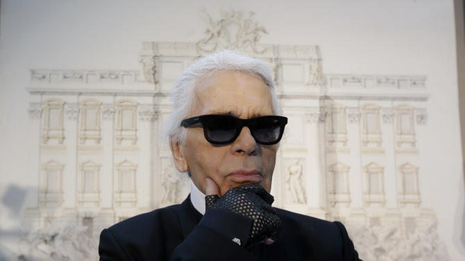 """Designer Karl Lagerfeld poses for photographers prior to the start of a press conference, in Rome, Monday, Jan. 28, 2013. The Fendi fashion house is financing an euro 2.12 million ($2.8 million) restoration of Trevi Fountain in Rome, famed as a setting for the film """"La Dolce Vita'' and the place where dreamers leave their coins. The 20-month project on one of the city's most iconic fountains was being unveiled at a city hall press conference Monday. (AP Photo/Gregorio Borgia)"""