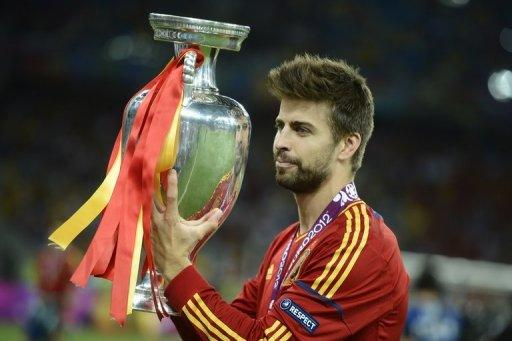 Spanish defender Gerard Pique holds the trophy