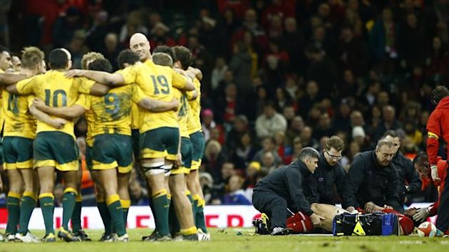 Wales' Leigh Halfpenny is treated for an injury during their international rugby union match against Australia at the Millenium Stadium in Cardiff