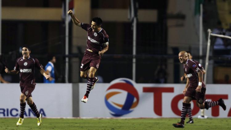 Goltz of Argentina's Lanus celebrates with teammates after scoring a goal against Brazil's Ponte Preta in their Copa Sudamericana first leg final soccer match in Sao Paulo