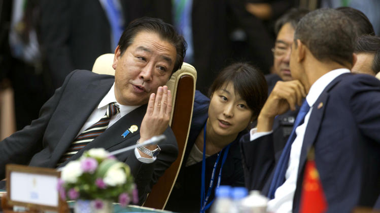 Japan's Prime Minister Yoshihiko Noda, left, speaks to U.S. President Barack Obama, right, as they arrive for the East Asian Summit Plenary Session at the Peace Palace in Phnom Penh, Cambodia, Tuesday, Nov. 20,  2012. (AP Photo/Carolyn Kaster)