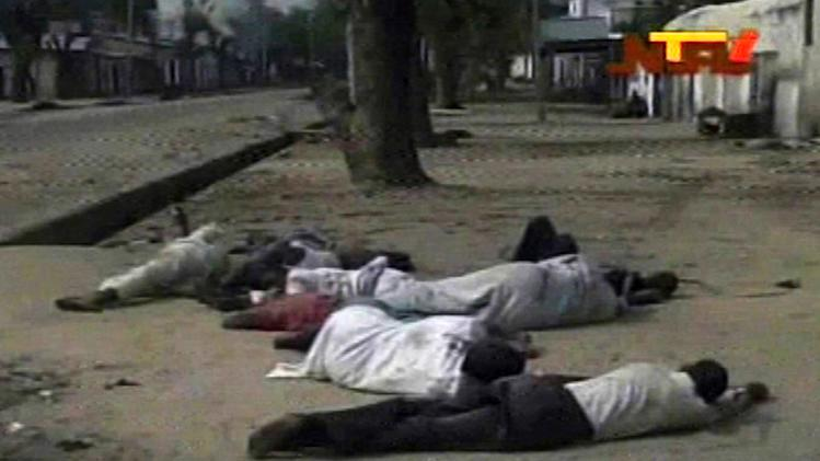 In this frame grab from TV footage shot by the Nigeria television authority on Monday, Oct. 8, 2012 but aired Tuesday, Oct. 9, 2012,  shows people lying down (condition of people unknown)  on a street in Maiduguri, Nigeria. Nigerian officials dumped dozens of corpses in front of a hospital in northeast Nigeria after soldiers opened fire and killed more than 30 civilians. The hospital, overwhelmed by the scale of the violence, had to turn away the dead as its morgue had no more room. The killings Monday come as besieged, underpaid and enraged soldiers remain targets of guerrilla attacks by the extremist Islamist sect, Boko Haram, which holds this city in the grip of bloody violence.  (AP Photo / Nigeria Television Authority)