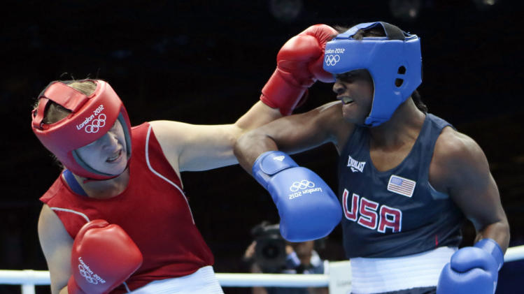Kazakhstan's Marina Volnova, left, fights United States' Claressa Shields during their middleweight 75-kg semifinal boxing match at the 2012 Summer Olympics, Wednesday, Aug. 8, 2012, in London.(AP Photo/Ivan Sekretarev)