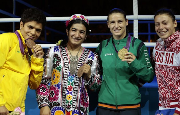 From left, bronze medalist Adriana Araujo of Brazil, bronze medalist Mavzuna Chorieva of Tajikistan, gold medalist Katie Taylor of Ireland, and silver medalist Sofya Ochigava of Russia, participate in the medals ceremony for women's lightweight 60-kg boxing at the 2012 Summer Olympics, Thursday, Aug. 9, 2012, in London. (AP Photo/Ivan Sekretarev)