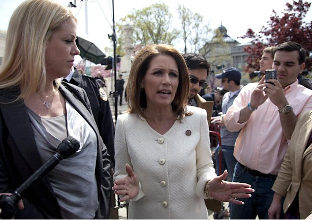 Rep. Michele Bachmann, R-Minn., right, accompanied by Florida Attorney General Pam Bondi, speaks in front of the Supreme Court in Washington, Wednesday, March 28, 2012, as the court concluded three da