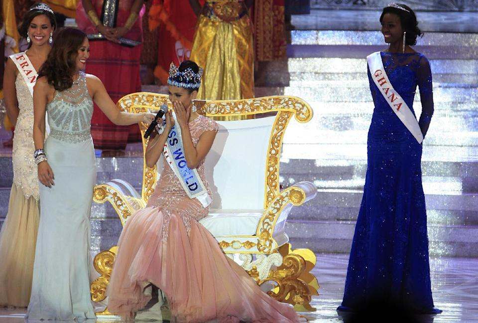 Newly crowned Miss World, Megan Young of the Philippines, center, reacts after winning the Miss World contest, in Nusa Dua, Bali, Indonesia, Saturday, Sept. 28, 2013. (AP Photo/Firdia Lisnawati)