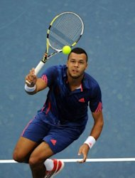 Jo-Wilfried Tsonga of France returns to Novak Djokovic of Serbia during the men&#39;s singles final at the China Open tennis tournament in Beijing on October 7, 2012. World number two Djokovic won 7-6, 6-2 to win the China Open for a third time