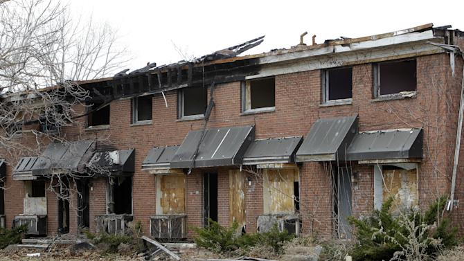 "Part of the Brewster-Douglass housing project site is shown in Detroit, Friday, March 18, 2011.  If Detroit Housing Commission director Eugene Jones  had his way the ""for sale"" sign he'd post off Interstates 75 and 375 would read: ""14 acres of prime real estate between the city's resurgent downtown and promising Midtown. A steal at $9 million. Will accept reasonable offer."" Real offers have been few. One arts group proposal to hang junked cars from windows in one the Brewster-Douglass housing project's empty 14-story towers was declined. Unlike cities like Chicago, where the last building in notorious Cabrini-Green public housing complex was razed within months of the final family moving out, Brewster-Douglass has been empty for two years and none of the 20 brick buildings has been torn down. Neither the city nor Jones' commission has the money to demolish the complex which is beginning to rival the long-empty, 17-story Michigan Central Depot as another symbol of Detroit's decay. (AP Photo/Paul Sancya)"