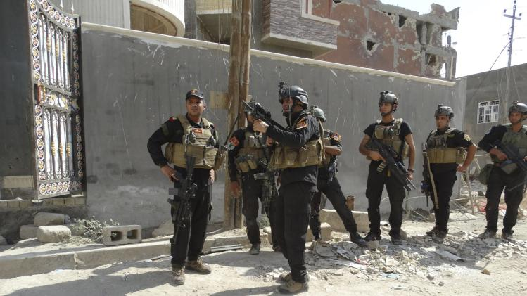 Members of the ISOF conduct a patrol looking for militants of the Islamic State in a neighbourhood in Ramadi
