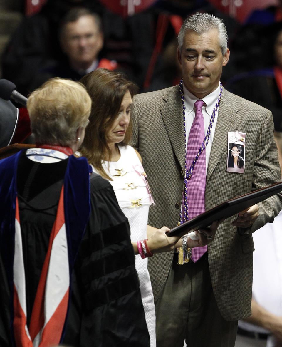 Darlene and David Harrison accept the degree from the University of Alabama on behalf of their daughter Ashley Harrison on Saturday, Aug. 6, 2011 in Tuscaloosa, Ala. Ashley lost her life when a tornado ripped through Tuscaloosa on April 27, 2011. (AP Photo/Butch Dill)