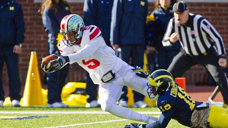 Ohio State quarterback Braxton Miller (5) dives in for a touchdown as