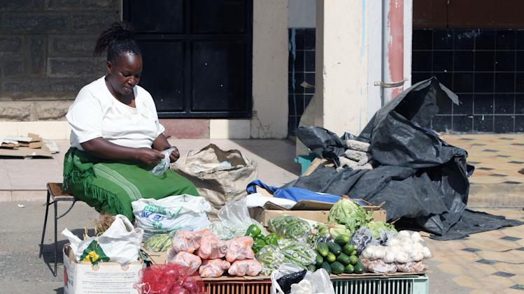 A woman roadside vegetable vendor displays her goods as the price of vegetables has doubled along with other foodstuffs since election day in Nairobi, Kenya, Thursday, March 7, 2013. Election officials across Kenya transported their local election results to be tallied in the capital Wednesday after the preliminary electronic vote counting system broke down. (AP Photo/Sayyid Azim)