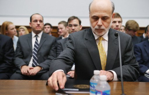 <p>Federal Reserve Board Chairman Ben Bernanke prepares to testify before the House Financial Services Committee on Capitol Hill July 18 in Washington, DC. The Federal Reserve's top policy makers are expected to shy away from taking new economic stimulus measures when they meet Tuesday and Wednesday, instead waiting until the economic picture becomes clearer.</p>
