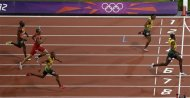 Jamaica&#39;s Usain Bolt crosses the finish line to win the gold medal in the men&#39;s 200-meter final during the athletics in the Olympic Park during the 2012 Summer Olympics, Thursday, Aug. 9, 2012, in London. (AP Photo/Mark Baker)
