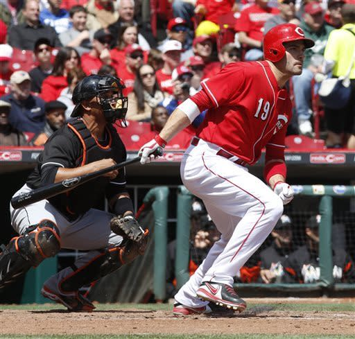 Phillips' sac fly in 13th wins it for Reds