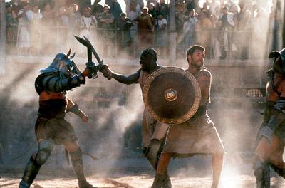 Chained together, Juba ( Djimon Hounsou ) and Maximus ( Russell Crowe ) get their first taste of gladiatorial combat in Dreamworks' Gladiator