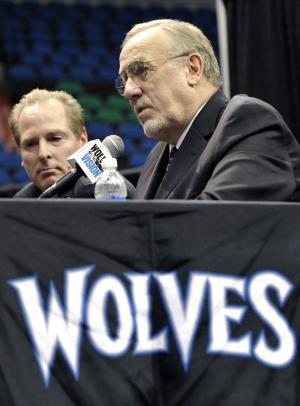 Rick Adelman, right, addresses the media after he was introduced as the Minnesota Timberwolves new head basketball coach during a news conference Wednesday, Sept. 28, 2011 in Minneapolis. Listening at left  is Timberwolves president of basketball operations, David Kahn. (AP Photo/Jim Mone)