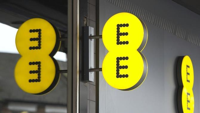 An Everything Everywhere (EE) mobile phone store sign is seen in London
