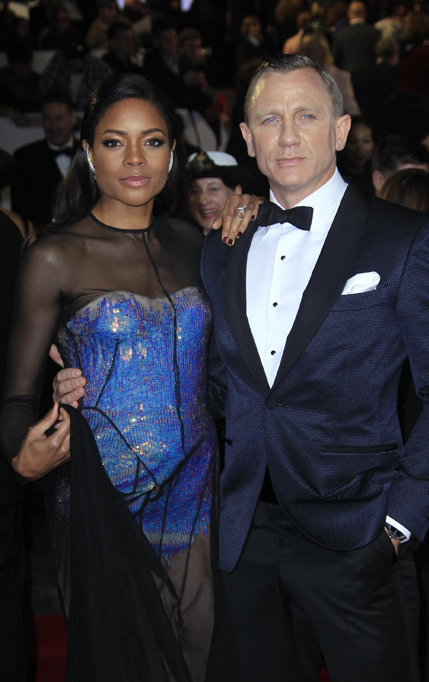 "Naomie Harris, left, and Daniel Craig arrive at the world premiere of ""Skyfall"" at the Royal Albert Hall on Tuesday, Oct. 23, 2012 in London. (Photo by Joel Ryan/Invision/AP)"