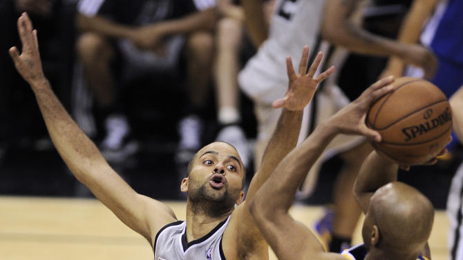 San Antonio Spurs' Tony Parker, left, of France, defends Golden State Warriors' Jarrett Jack during the second half of Game 1 of the Western Conference semifinal NBA basketball playoff series, Monday, May 6, 2013, in San Antonio. San Antonio won 129-127 in double overtime. (AP Photo/Darren Abate)
