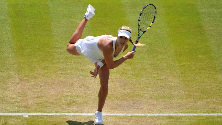 Canada's Eugenie Bouchard returns to Germany's Angelique Kerber during their quarter-final match at Wimbledon on July 2, 2014