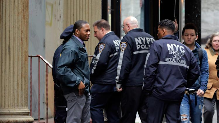 New York City Police and members of the Office of the Chief Medical Examiner enter a building in Lower Manhattan Monday, April 29, 2013, near the place where a rusted metal part from the wing of a Boeing 767 was found wedged between a mosque and an apartment building on Friday, April 26. Investigators initially thought it was part of the landing gear, because both pieces have similar hydraulics. Authorities believe the aircraft part is from one of the two hijacked planes used in the Sept. 11 attacks on the nearby World Trade Center. The medical examiner's office said Monday it is preparing the site and plans to begin sifting for human remains in the area on Tuesday, April 30. (AP Photo/Richard Drew)