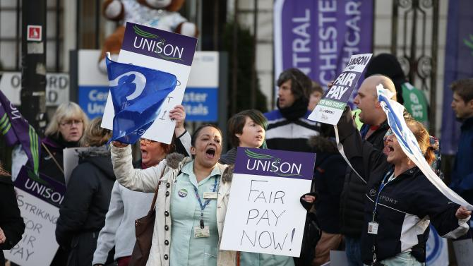 NHS workers stand on a picket line outside Manchester Royal Infirmary in Manchester, northern England