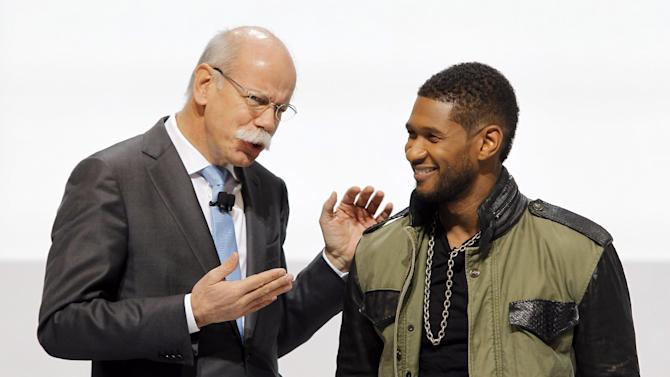 Chairman of Daimler AG Dieter Zetsche of Germany, left, chats with US singer Usher, right, who presented the new A 45 AMG car during the first media day of the 83rd Geneva International Motor Show, Switzerland, Tuesday, March 5, 2013. The Motor Show will open its gates to the public from March 7 to 17.  (AP Photo/Laurent Cipriani)