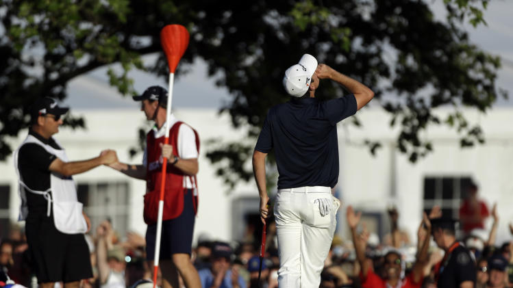 Justin Rose, of England, reacts after a putt on the 18th hole during the fourth round of the U.S. Open golf tournament at Merion Golf Club, Sunday, June 16, 2013, in Ardmore, Pa. (AP Photo/Julio Cortez)