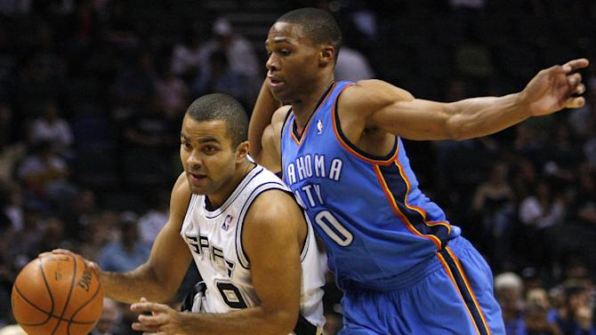 FILE - In this Dec. 14, 2008, file photo, San Antonio Spurs guard Tony Parker, left, of France, drives around Oklahoma City Thunder guard Russell Westbrook (0) during the first half of an NBA basketball game in San Antonio. Parker had two NBA titles when he was Westbrook's age. That makes the All-Star point guards chasing different legacies in what will be the marquee matchup of the Western Conference Finals.(AP Photo/Darren Abate, File)