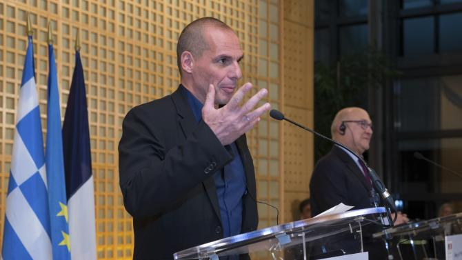 French Finance Minister Sapin and Greek Finance Minister Varoufakis attend a joint news conference in Paris
