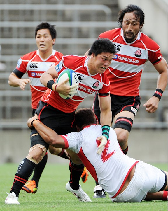 Japan's wing Toshiaki Hirose is tackled
