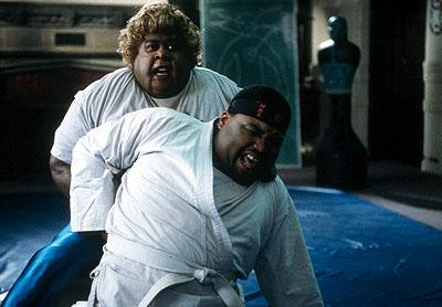Big Momma ( Martin Lawrence ) gives Nolan ( Anthony Anderson ) a lesson in proper martial arts technique in 20th Century Fox's Big Momma's House