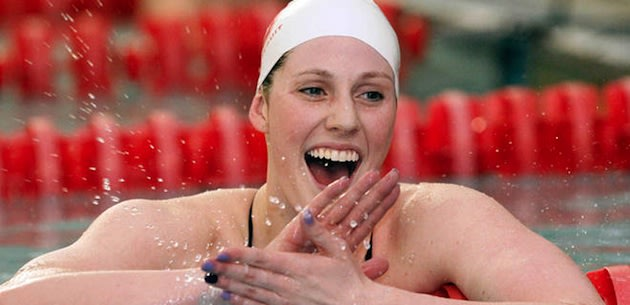 Missy Franklin celebrates while wearing her Regis Jesuit cap — AP