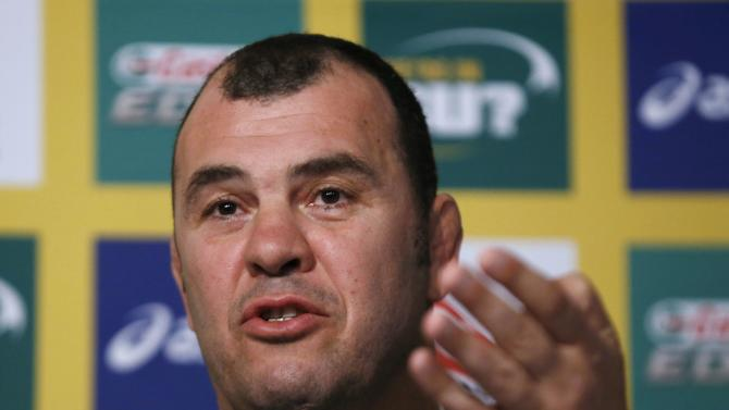 Michael Cheika answers a question at a news conference where he was announced as the new Australian Wallabies Rugby Union team coach in Sydney
