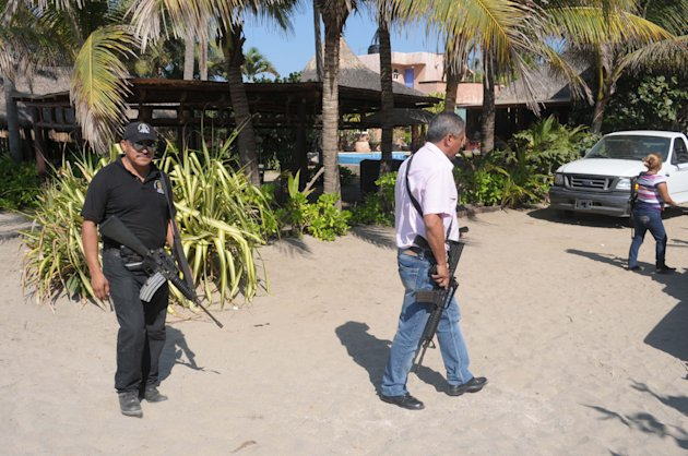 <p>               Police patrol on the beach outside a home after masked armed men broke into the home in Acapulco, Mexico, Tuesday Feb. 5, 2013. According to the mayor of Acapulco, five masked men burst into the house that Spanish tourists had rented on the outskirts of Acapulco, in a low-key area near the beach, and held a group of six Spanish men and one Mexican woman at gunpoint, while they raped the six Spanish women before dawn on Monday. (AP Photo/Bernandino Hernandez)