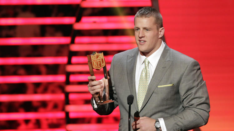 J.J. Watt of the Houston Texans accepts the AP Defensive Player of the Year award at the 2nd Annual NFL Honors on Saturday, Feb. 2, 2013 in New Orleans. (Photo by AJ Mast/Invision/AP)