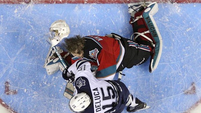 Kelowna Rockets goalie Jackson Whistle loses his helmet after being hit by Rimouski Oceanics Anthony Deluca during the second period of their Memorial Cup hockey game at the Colisee Pepsi in Quebec City